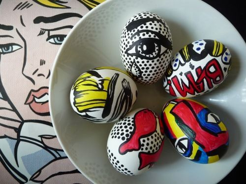 Painted eggs inspired by artist Roy Lichtenstein's comic book images.