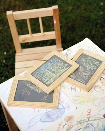 kids entertainment table at a wedding- low table with small chairs. coloring pages, crosswords, dot-to-dot pages etc