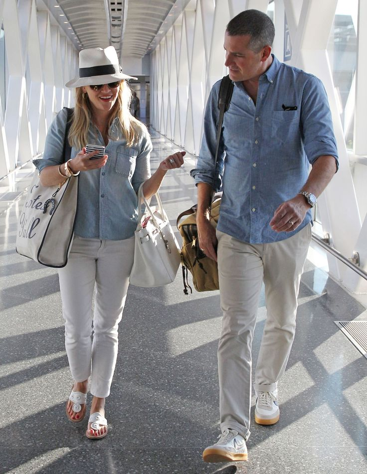 Reese Witherspoon and Her Husband Jet Set in Matching Outfits and using her Minnie and Emma phone case from #InStyle