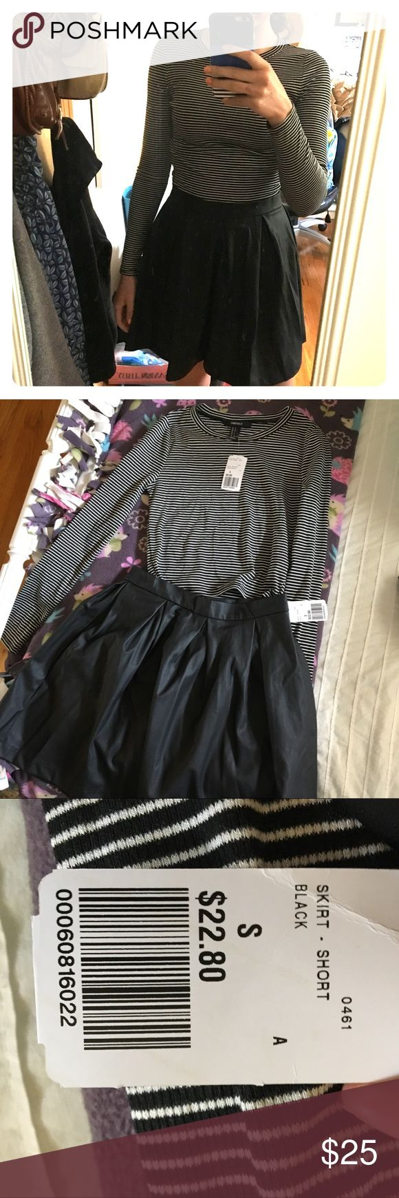 Forever 21 Faux Leather Skirt and Striped Croptop I bought these pieces together last year so I figured I'd sell them together! I am willing to separate if you only want one of the two pieces, but the set would look so cute as just a casual look or you could dress it up for dinner! The skirt is really comfortable because it has a silk lining and the shirt is cropped but when worn with the skirt no midriff is shown. Forever 21 Skirts