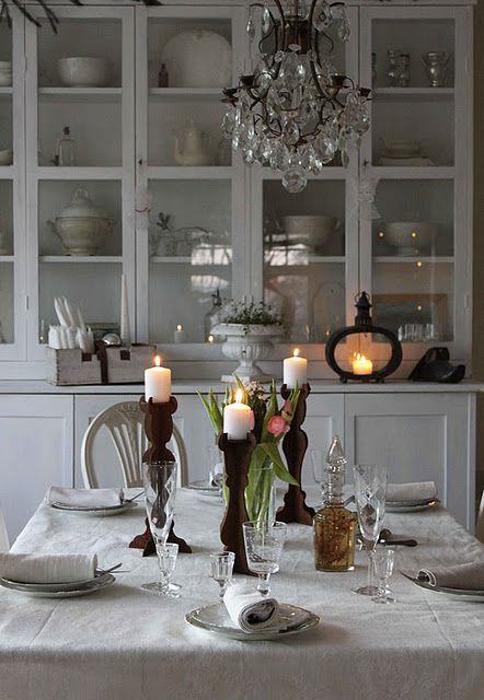 Pretty farmhouse dining room, white, chandelier, cabinet, ironstone, shabby chic