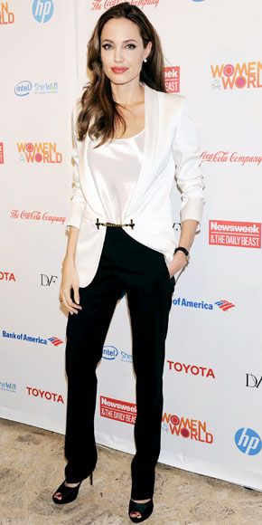 For the Women in the World Summit, Angelina Jolie suited up in a black and white Gucci ensemble and Pearl Paradise stud earrings.
