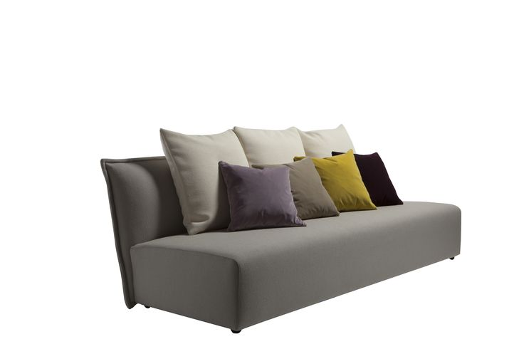 """#TheDesignerSpeaking - Purple, the free sofa.  """"It's been designed without arms: the base and the seatback perfectly fit every mood, transforming it into a Baroque object, extremely minimalist or glamour. Thanks to the high seatback and the numerous cushions it is a real protective nest. Small tables, poufs, coffee tables and accessories of different sizes can be matched together to realize any project in which Purple is the protagonist."""" Marco Viola"""