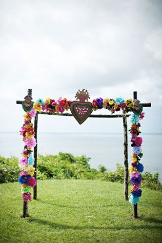 This Mexican-inspired ceremony arch is perfect for a fun and funky couple! // Photo courtesy of Jillian Mitchell.