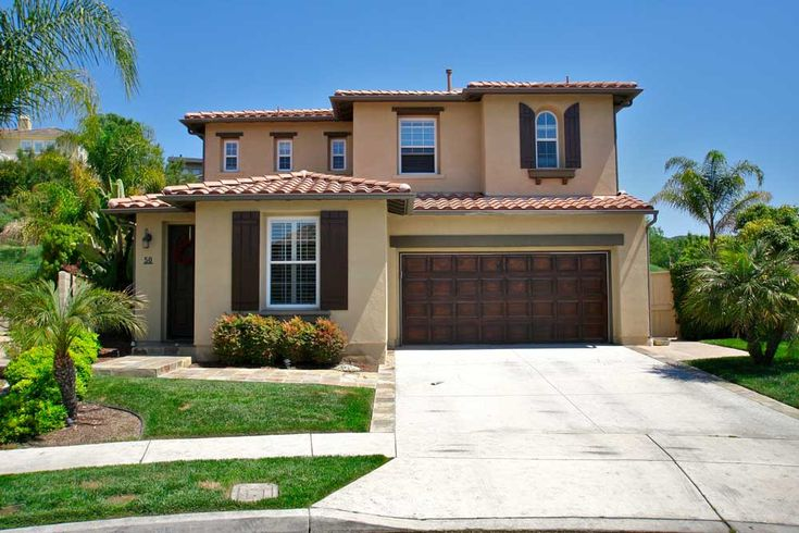Tuscan style facade moca stucco cafe shutters and garage for Homes with big garages for sale