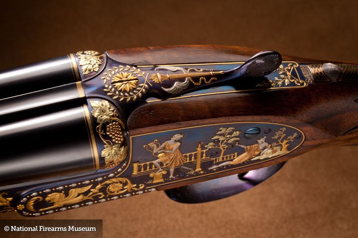 A truly unique Holland & Holland engraved by the famous Brown Brothers utilizing a blued background with multicolored gold inlays and platinum.  The theme is classical  mythology, not commonly found on sporting guns. It is housed in a custom wood case protected by an aluminum case as the outer cover.