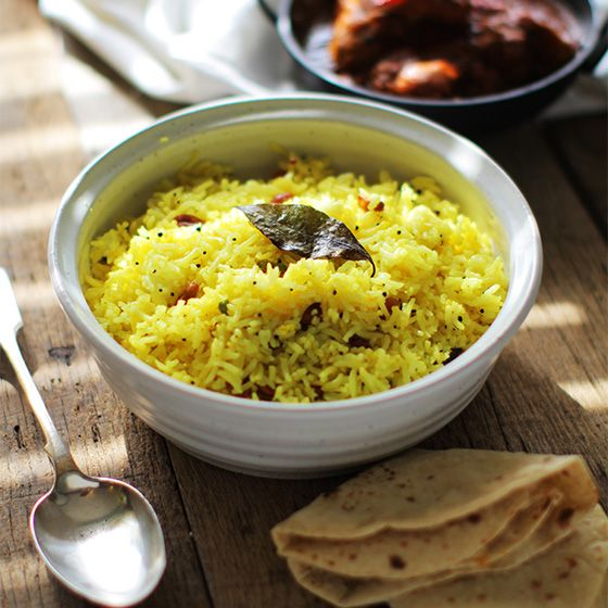 Lemon Rice - Fresh and fragrant lemon rice cooked with nuts and lightly toasted spices. A cracking South Indian dish great to eat on its own or as a side. There are so many different things you can do with rice, from cooking the rice with different ingredients as in a briyani or a pilau, or using left over rice and add some new simple flavours and textures to create an altogether new dish. This dish has a hint of lemon, which adds freshness.