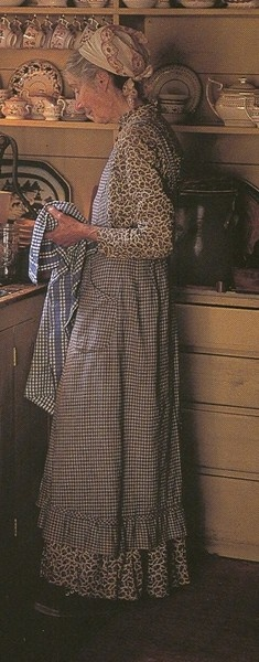 Tasha Tudor - working efficiently in the clothing of the past century. Even the mixed patterns work.