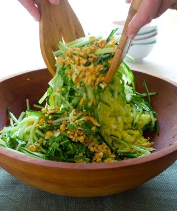 tossing cucumber and napa cabbage coleslaw with peanuts - crunch and delicious with lots of lime and cilantro. Oh yes.
