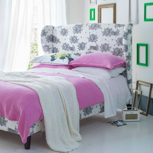 "The striking bed may be a traditional style in a country-inspired cabbages and rabbits print but when given some neon pink bed sheets and placed in front of a feature walll of colourful frameless picture frames, the look is modern and whimsical.   Angelica Double Bed in Rabbits & Cabbages, £1,365 at [link url=""http://www.sofa.com""]Sofa.com[/link]  [link url=""http://www.houseandgarden.co.uk/homes/hanging-pictures-cool-ways-to-hang-pictures""]Unique ways to display pictures in your home[/link]"