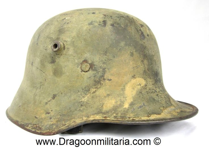 """WW1 German M17-helmet. Maker stamp bit obscure""""ET 66""""? and batch number """" 914 N"""" inside at shell dome. Helmet has light brown camo at shell. Camo has been partly removed, but  still retains most of it.  Typical WW2 period finnish army camo in light brown."""