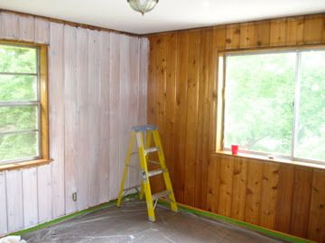 Just a Touch of Gray: Whitewash Treatment over real knotty pine paneling. Great final result.