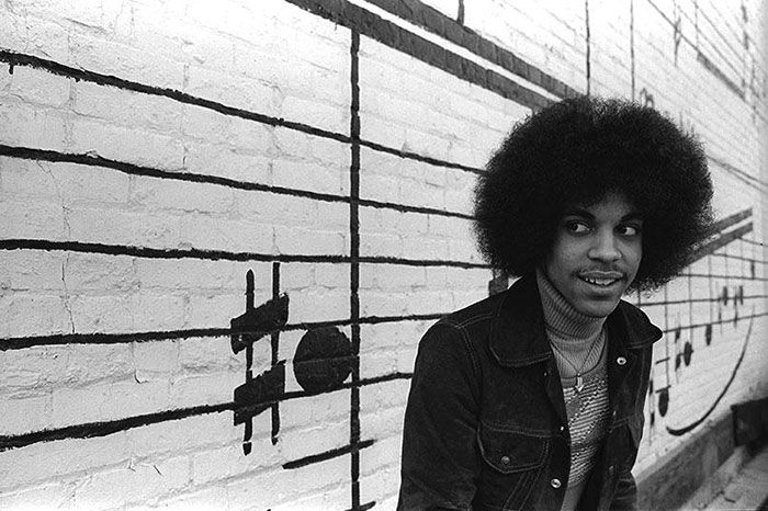 Rare Photos Of 19-Year-Old Prince Outside Minneapolis' Old Schmitt Music Headquarters In 1977