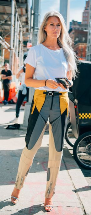 British Vogue's Sarah Harris proves that last season's biker trend still has serious legs. Trousers like this need no bells and whistles, a plain white tee and a flowing silver mane will do. #styledotTon
