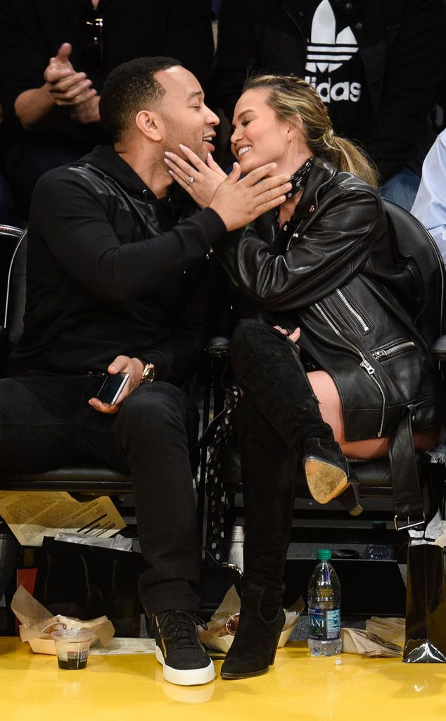 John Legend & Chrissy Teigen from The Big Picture: Today's Hot Pics  All of me loves all of you! The expectant couple prove courtside is a perfect place to show PDA as they look adorable at the L.A. Lakers game.
