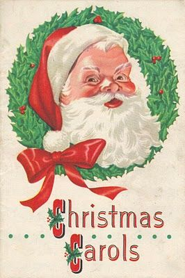 Vintage Christmas Carols book cover with Santa Claus and a holly wreath.