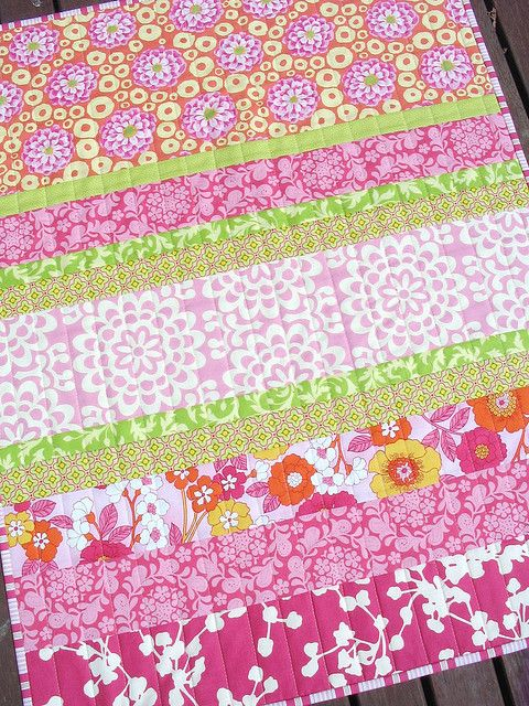 very cute pink and green strip quilt-I like that it was quilted down instead of in the stripes.
