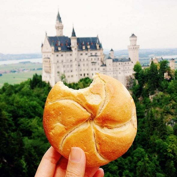 Breadroll at #neuschwanstein Castle aka the Real Life Cinderella Castle in #germany. Photo GirlEatWorld l #food #breadroll #cinderellacastle #travel #travelphotography #mouthwatering #girleatworld