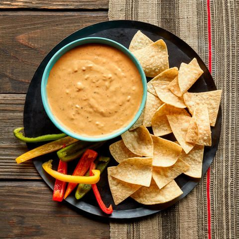 "Back in 1939, Sunset published a dip recipe from reader M.K.C. of Elk Grove, California, for La Salsa con Queso--""a lively dish from Mexico,"" as we described it, made with canned tomatoes, diced American cheese, and a whisper of fresh chile. While its origins are up for debate--Texas and Arkansas have also claimed the recipe--the dip (now called chile con queso, or simply queso) is still a crowd-pleaser. Our update on the classic, perfect for Super Bowl Sunday or another sports fest..."