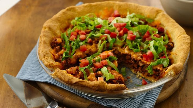Easy Crescent Taco Bake recipe and reviews - We just love this easy five-ingredient taco casserole recipe. Fill a buttery crescent roll crust with your favourite taco fixings, then prepare to join the clean plate club. Top with shredded lettuce and tomato for an even more authentic taco experience.