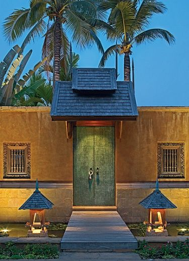 """Thailand - The front gate. The skin of the door was fashioned out of small copper sheets; a Buddha's hands serve as handles and are positioned symbolically """"so you enter the house in peace,"""" explains Bensley. Architecture, Interior and Landscape Design by"""
