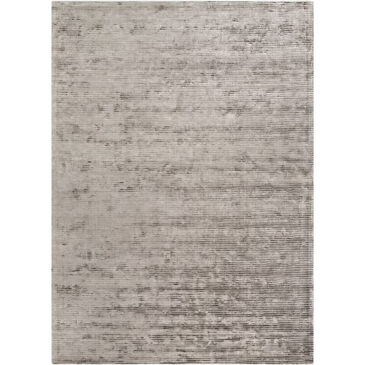 Grey distressed area rug at Avenue Design Canada in Montreal Qc.