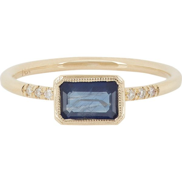Jennie Kwon's ring is crafted of gold bezel-set with an emerald-cut sapphire. The horizontally placed sapphire is flanked by pavediamonds. .