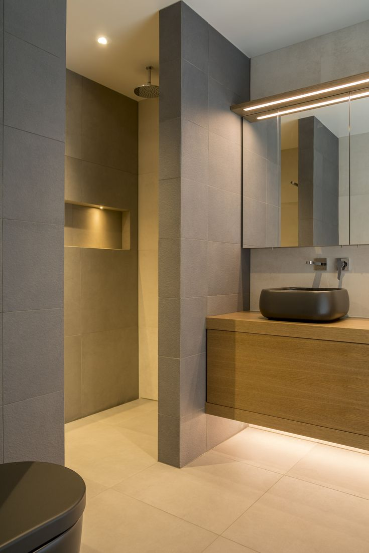surfacedesign entry-level tiled shower with slip-drain and recessed shelf.