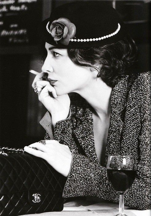Coco Chanel with pearls on her hat, what an interesting idea