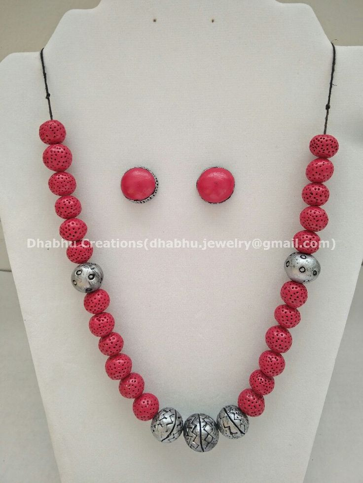 Pink and silver neck piece
