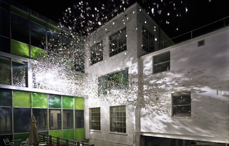 Art installation at Clark Shoes International Headquarters / ROSO - The installation itself was developed from a single observation - Light is only seen when reflected. A light beam coming through a window is only visible because light is reflected in the millions of dust particles floating in the air