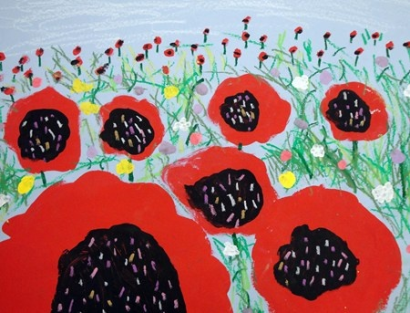 Started by adding the white clouds in the distance. Then, paint large red poppies in the foreground, medium sized poppies in the middle ground, and very small poppies in the background to create depth. Then used a variety of green oil pastels to draw stems and grass and then painted white and yellow flowers to add even more interest. Finally, paint the centers of the poppies with black paint and add more detail using white and yellow oil pastels.