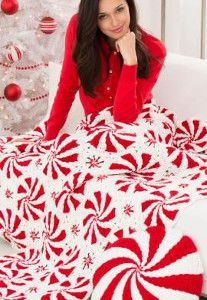 The most deliciously festive Christmas crochet pattern is here. Try this Peppermint Winter Crochet throw! It even comes with a crochet pillow pattern! | AllFreeCrochetAfghanPatterns.com
