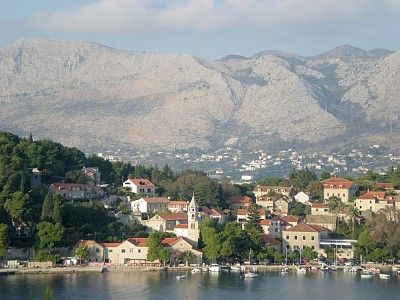 Cavtat, Croatia - bus #10 from Dubrovnik takes 30-45 minutes to arrive in Cavtat that only costs a few kunas. There is a small town for tourists, there are beaches, restaurants, hotels, etc. Great for one night.