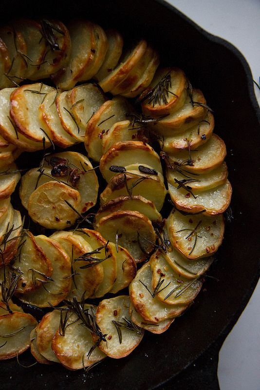 Skillet Baked Potatoes with Chili Garlic and Rosemary Oil from  Heatherchristo,com