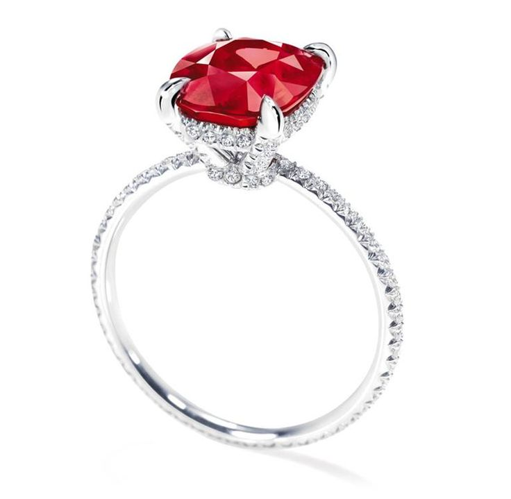 Harry Winston Ruby with Micropave Diamonds. Cushion-cut ruby, 3.03 carats; 92 round diamonds, 0.49 total carats; platinum setting.