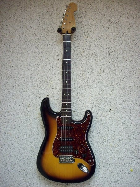 The 'Ole battleaxe - 1994 Mexican Stratocaster with HSS Rio Grande pups. this guitar has been with me for almost 20 years now. Not the finest strat but definitely a workhorse. Best 400 bucks I ever spent.