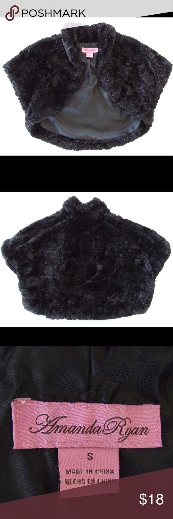 """Amanda Ryan faux fur bolero jacket, evening wrap This is a sweet little bolero jacket by Amanda Ryan, in size small.  It would look so cute over a strapless or sleeveless dress for evening or parties!  It is black faux fur with a nappy texture to imitate Persian Lamb.  Shawl collar with cap sleeves.  Lined in black.  100% Polyester.  This jacket/wrap is NWOT, in excellent condition.  Size is flexible as it is open in front. Measurements taken flat are bust 16-18"""", length 11"""" in front, 15"""" in…"""