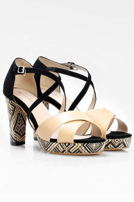 Pretty pair of shoes by Sepatuku baru with strappy design & pretty woven heels. Pair with mini dress & braided hair to look sweet & sophisticated. http://www.zocko.com/z/JIUnX