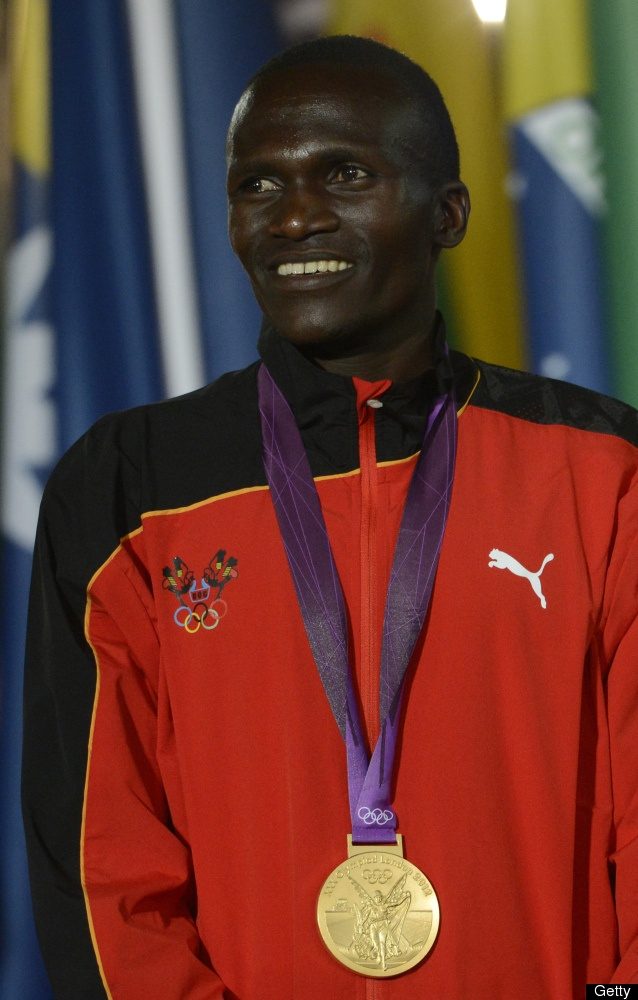 Uganda's gold medalist Stephen Kiprotich poses on the podium of the men's marathon during the closing ceremony of the 2012 London Olympic Games at the Olympic stadium in London on August 12, 2012.