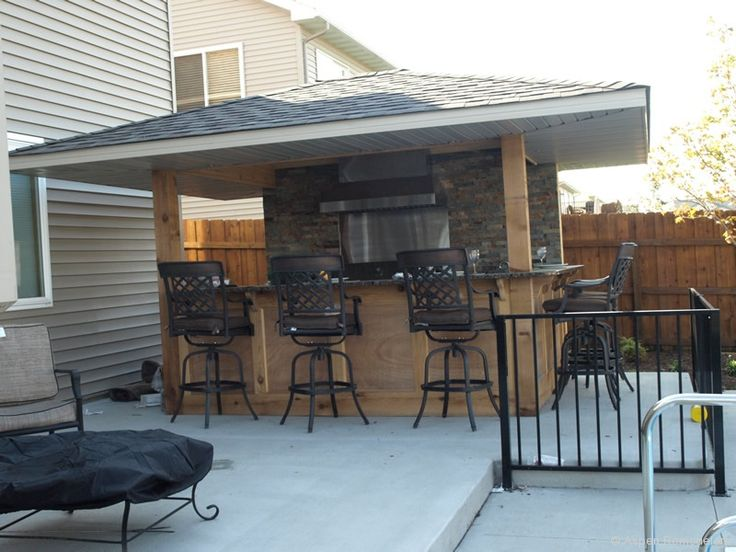 Great use of a small space for a covered outdoor kitchen for Small kitchen eating area ideas
