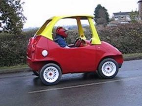 A custom car shop in England has built a street-legal, motorized replica of the classic Little Tikes Cozy Coupe toy car
