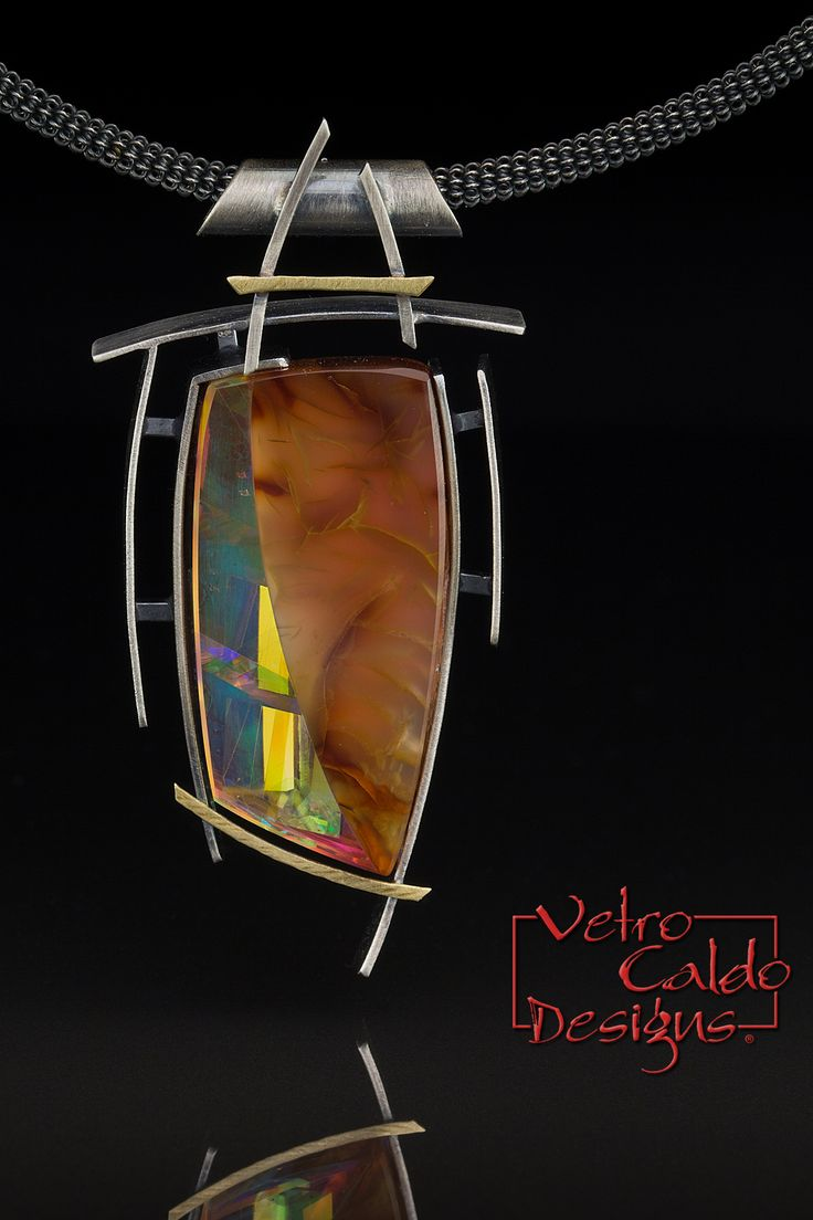 Carnelian infused with optical glass and dichroic glass, 18kt gold, oxidized sterling silver. © Vetro Caldo Designs