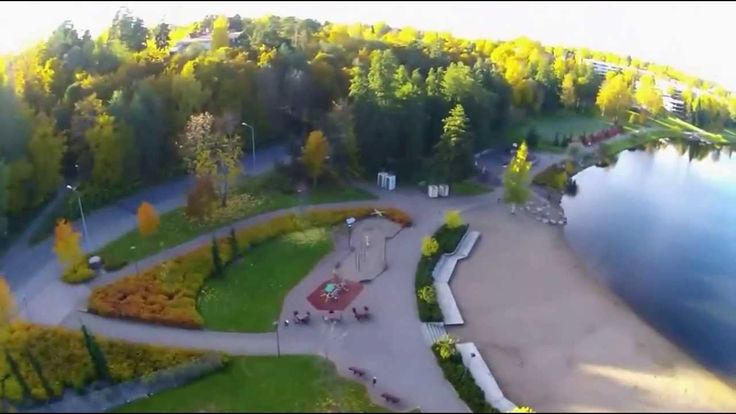Aerial over Valkeisenlampi-pond park in the middle of the city in Kuopio, Finland.