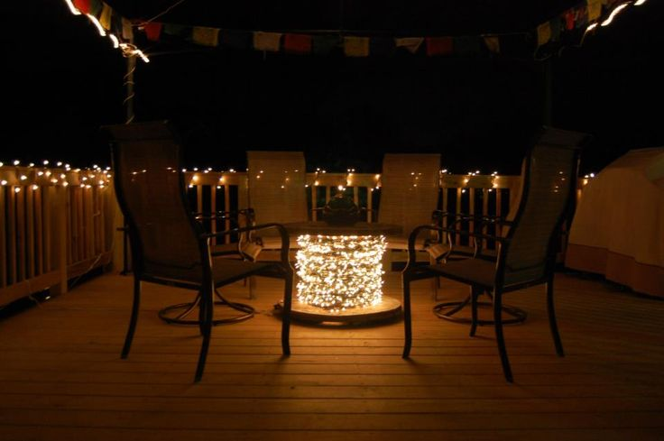 Wire spool table with lights.  Defiantly doing this one under the gazebo
