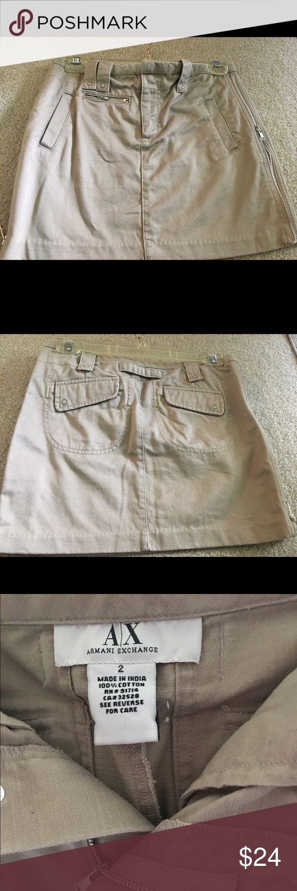 Khaki Armani Exchange Mini Skirt Khaki mini skirt by Armani Exchange. Only wore once. Doesn't fit anymore. Front slit pockets. Zip up front. 2 back pockets. Super cute. Size 2. A/X Armani Exchange Skirts Mini