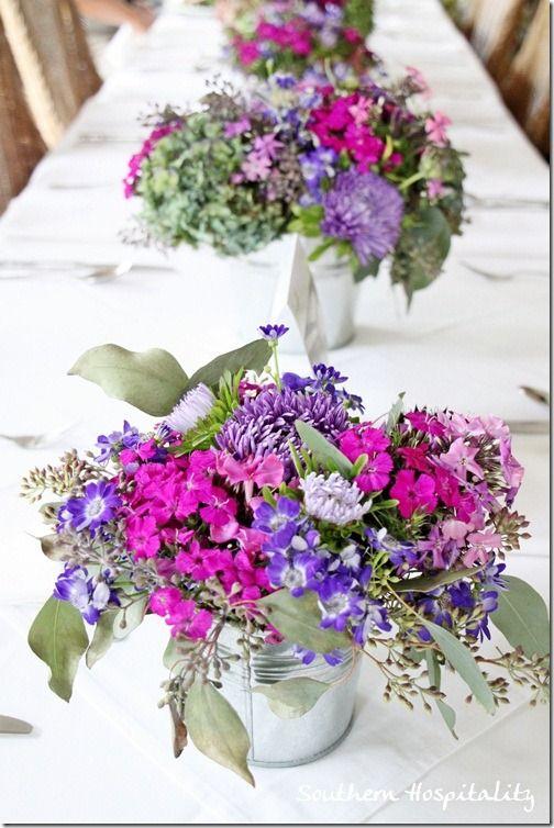 purple flowers in galvanized buckets on tablePurple Flower