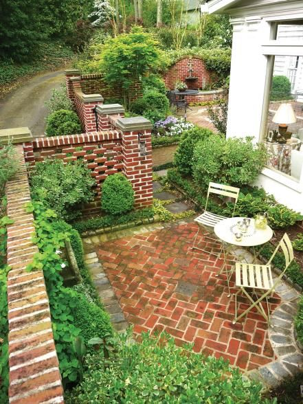A+brick+wall+is+a+classic+choice+when+it+comes+to+creating+a+privacy+fence.+Flowers,+shrubs+and+a+water+feature+soften+the+brick+in+this+courtyard+to+create+a+cozy+outdoor+retreat.
