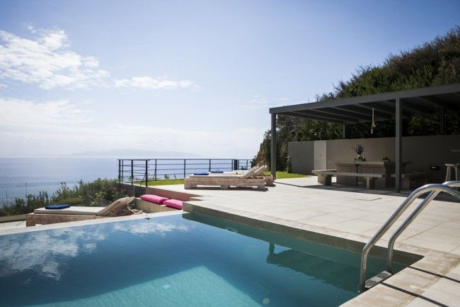 Clear blue sky, deep blue seas, sparkling clear water in the swimming pool, rich, green rural tranquillity and the dramatic, craggy back-drop of Kefalonia's Mount Aenos