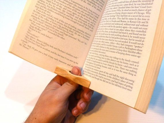 For the reader who has everything... except a spare hand.   This thumb-ring will make it even easier to hold open your favorite book until you're done reading your favorite book or zine.